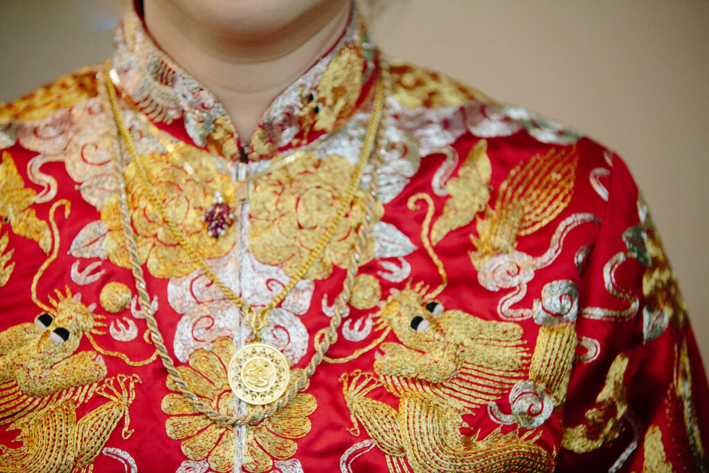 Traditional red dress details for tea ceremony