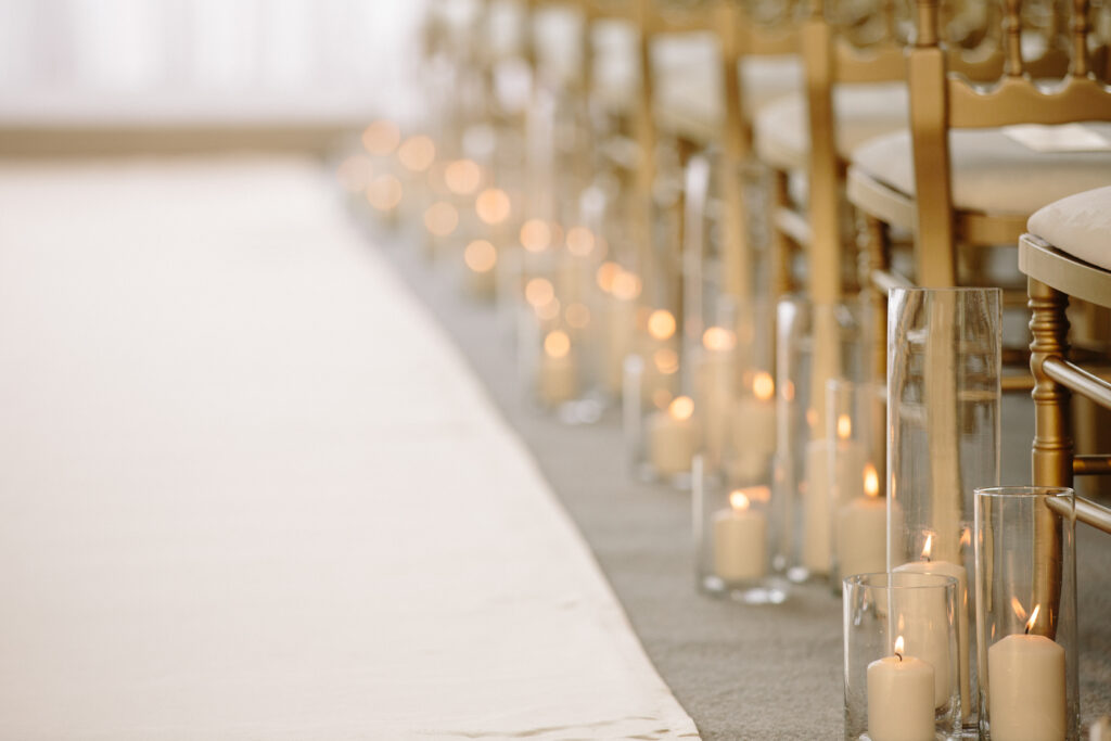Candle lit aisle at a wedding ceremony